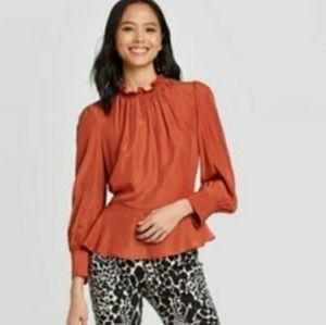 Long sleeve shirred ruffled high neck blouse